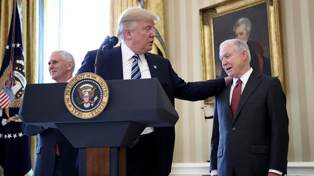Jeff Sessions (right) was mocked by Rockstar in Red Dead Redemption 2. The Red Dead Redemption 2 Jeff Sessions easter egg is found in a newspaper article.