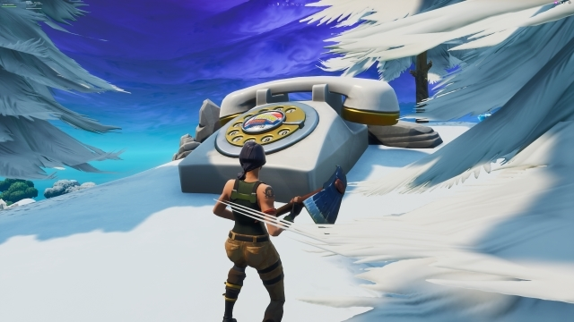 Fortnite Visit an Oversized Phone a Big Piano and a Giant Dancing Fish Trophy